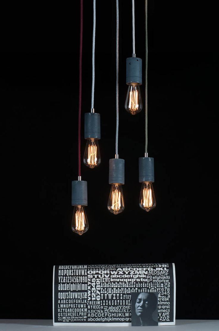 Our classic Kalla - concrete pendant lamps - here in anthracite colour with steel elements and cotton braided cables with vintage Edison lightbulbs #concrete #design #lighting #lamp