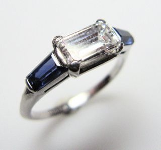 Ascher cut diamond ring  1950s  A 1950s certificated ascher cut diamond ring (E colour, vvs clarity, 1.11cts) Set with baguette natural sapphire shoulders. All in platinum and signed Tiffany. (Price: $19800) i couldn't complain :x