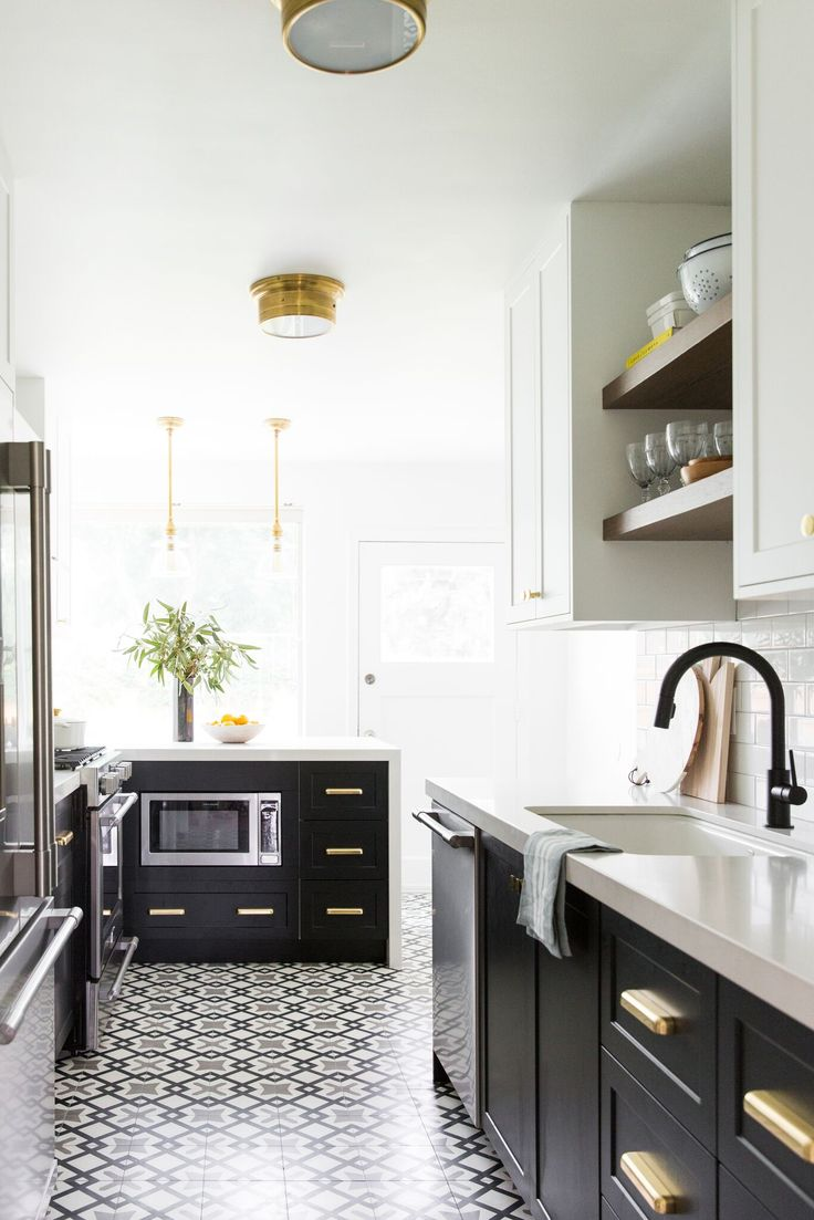 Patterned cement tile and two toned cabinets in a small bright kitchen, navy instead of black