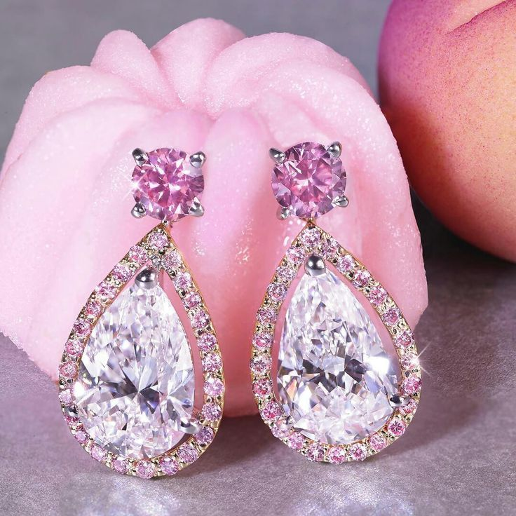 @moussaieffjewellers. Sumptuous vivid pink diamond earrings containing white diamond pears. #moussaieff #magnificentjewels #moussaieffjewellers #pinkdiamonds