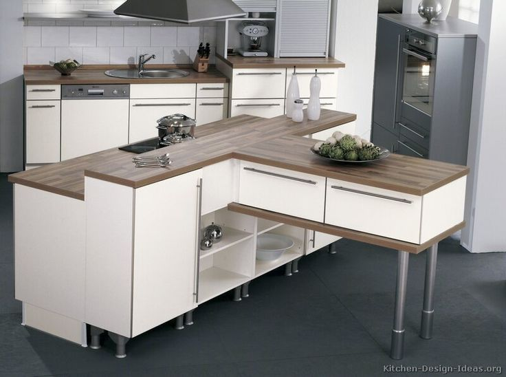 #Kitchen Idea of the Day: Modern white kitchen with a unique kitchen island shape. (By ALNO, AG)