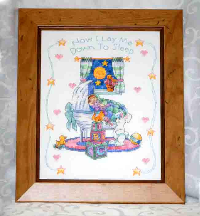 The perfect gift to announce the birth of a new baby, an angelic baby sleeps under a colourful blanket in a beautiful crib watched over by Mr. Bunny. The words 'Now I Lay Me Down to Sleep' adorn the top of the embroidery. This precious heirloom will be treasured  for years to come. Personalise with the baby's name and date of birth.