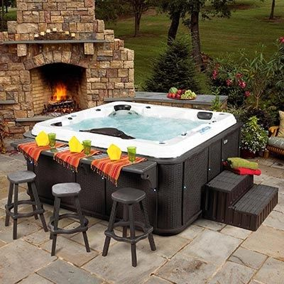 A hot tub with a bar counter. Amazing idea
