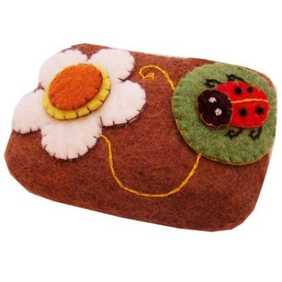 Felt purse, brown with flower and cute ladybird, handmade in Nepal.  See more... http://www.thefairtradestore.co.uk/fair-trade-children-s-gifts/felt-purse-brown-with-flower-and-ladybird/prod_660.html  #Fairtrade #Felt #Ladybird #Nepal #Purse