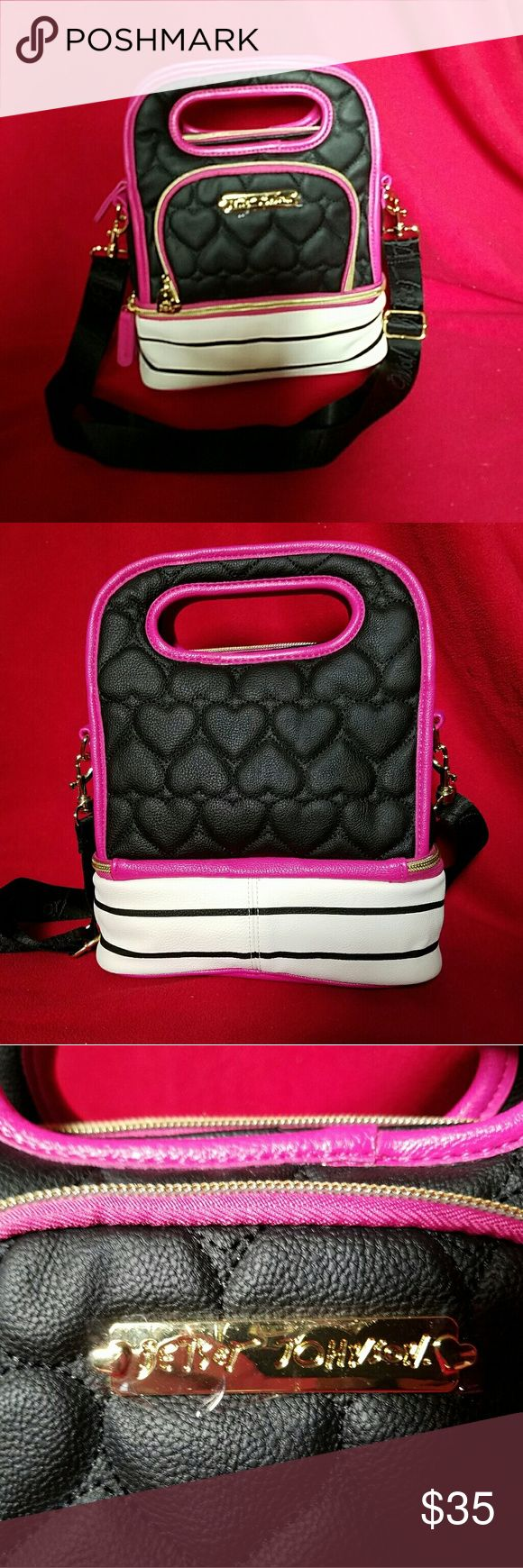 Betsey Johnson Lunch Box NWOT. Still has the plastic over the name plate.Two compartment lunch box. Black top half, white with black stripped bottom, all outlined in pink. Betsey Johnson Bags