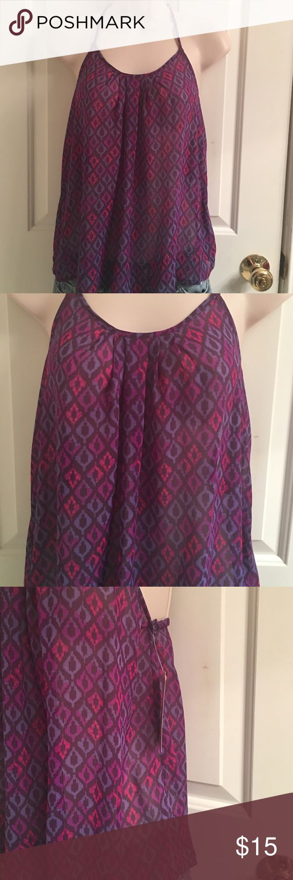 NWT- Arizona Purple Loose Fitting Racerback Tank NWT- Junior women's Arizona purple loose fitting tank top. Lightweight. Spaghetti strap. Crochet racerback, with elastic around the back. Size small. Excellent condition. 100% Polyester Arizona Jean Company Tops Tank Tops