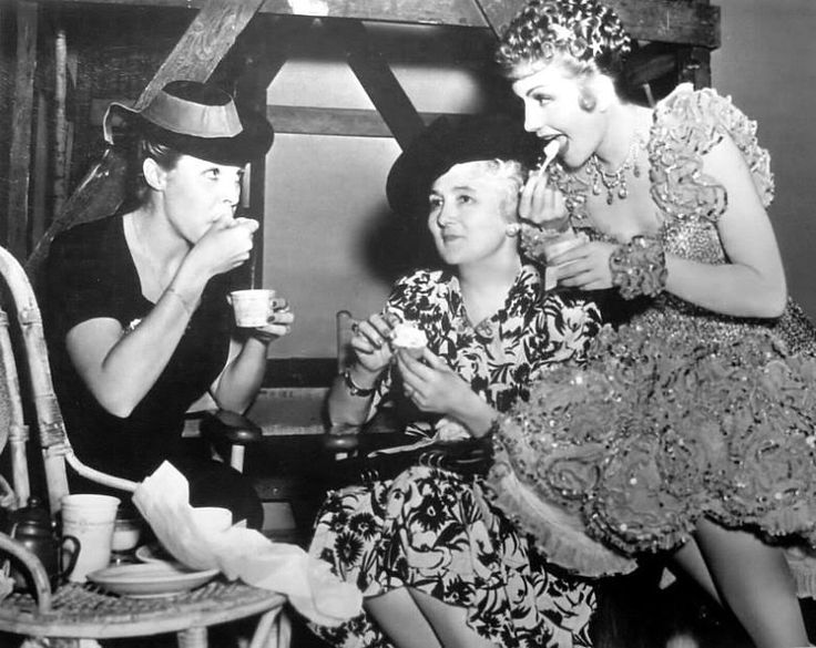 """Claudette Colbert takes a breather during the filming of """"Zaza"""" and shares ice creams with visitor Martha Raye, and her own mother, Jeanne Chauchoin in 1939."""
