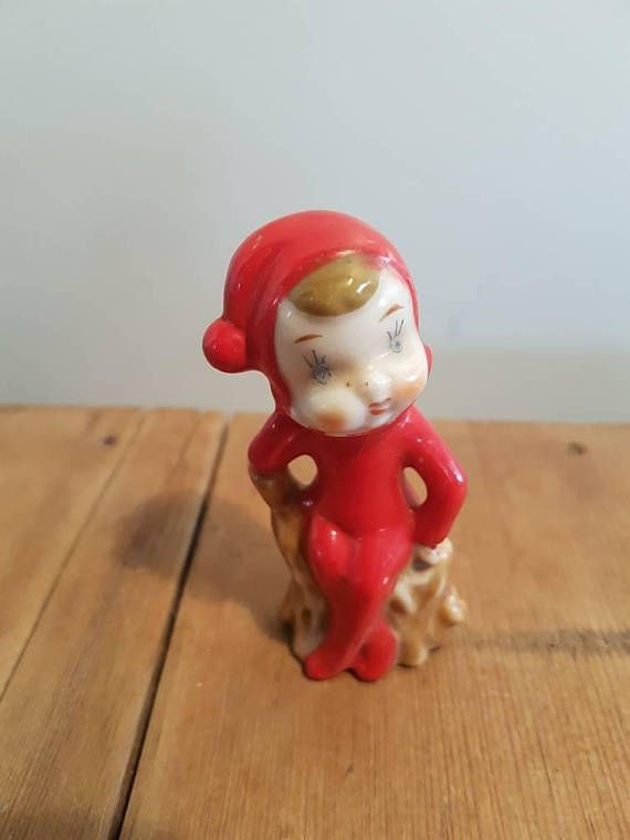 Check out this item in my Etsy shop https://www.etsy.com/au/listing/534288754/vintage-pixie-elf-sitting-on-a-log