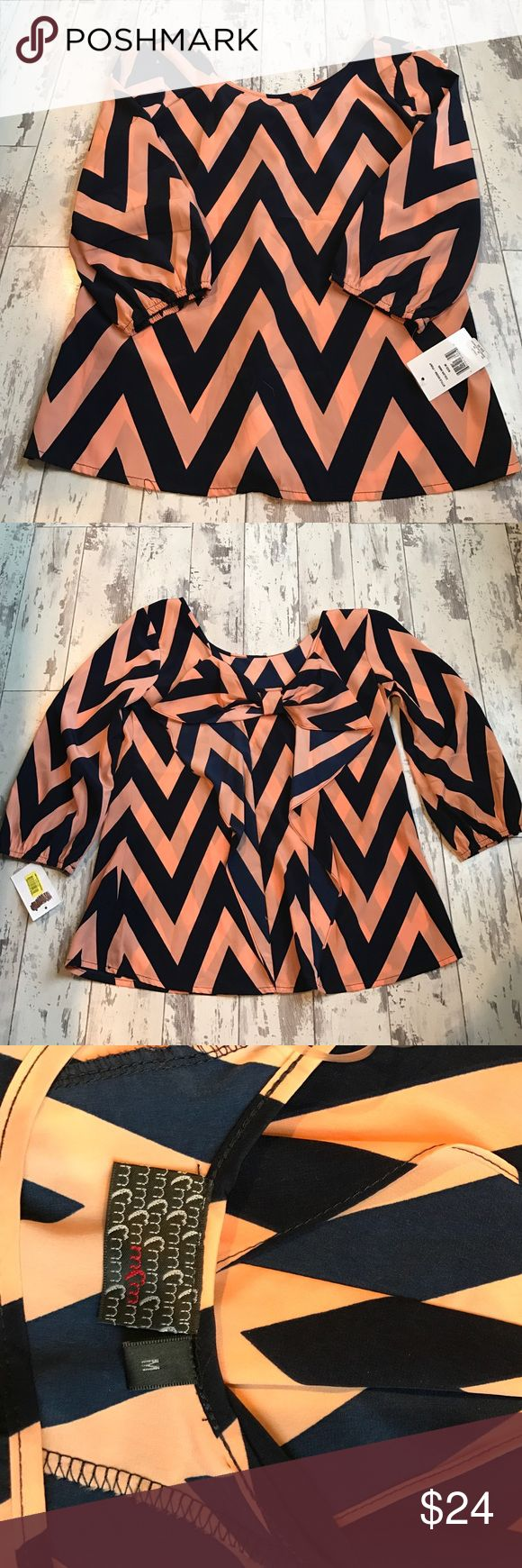 Chevron top Navy blue & peach chevron top with bow on back. Size medium, new with tags. From Dillard's. mm Tops Blouses