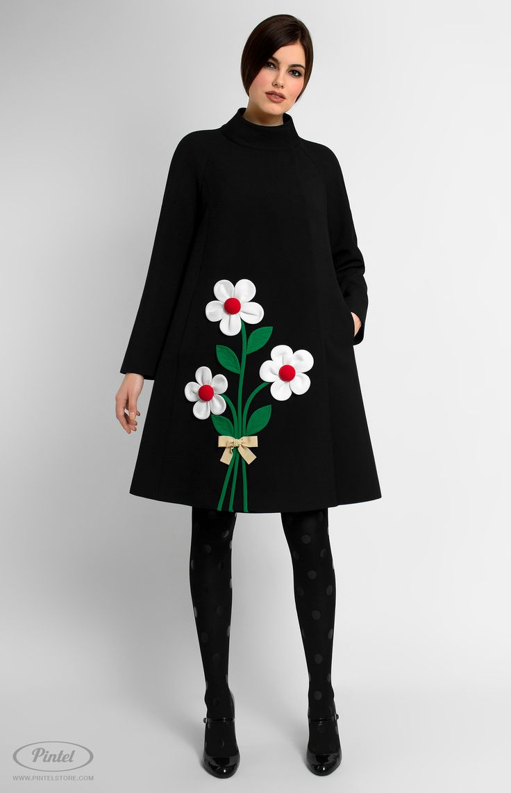 Long sleeve A-shape genuine wool coat. Band collar. Hidden front pins. Decorated with designer handmade true-wool and cotton flowers. Side seam pockets. Back box pleat.