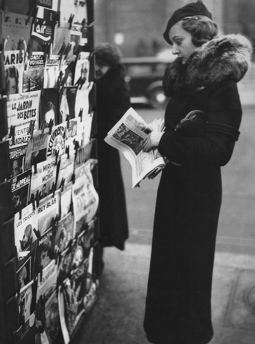 Miss Paris 1934. Elisabeth Argal browsing a newsstand on the morning after her triumph.