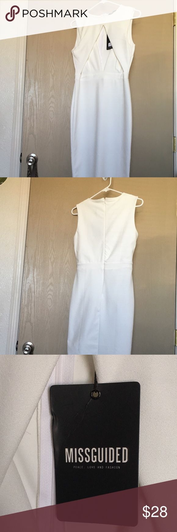 White midi length dress White dress. Comes to about knee length or a little bit under. Has cutouts in the front to show cleavage and smaller cutouts on the sides to show a bit more skin misguided Dresses Midi