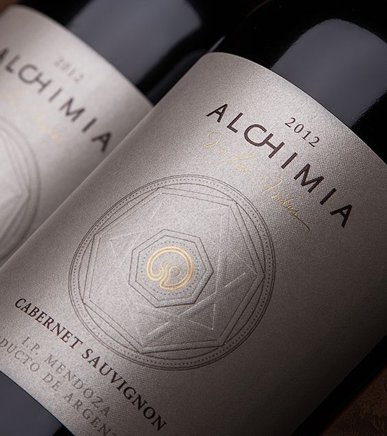 A long time ago, the alchemists sustained there were four natural elements (fire, air, water and earth) which, combined together, would produce a fifth element: the wine.  The label Reserve of this wine designed by Caliptra represents the union of these 4 elements.  All the design is in metallic sand, except for the center in gold which represents the sun  on the Argentinian flag. This golden point concentrates all the attention and energy. When you see this sun, you see all the country.
