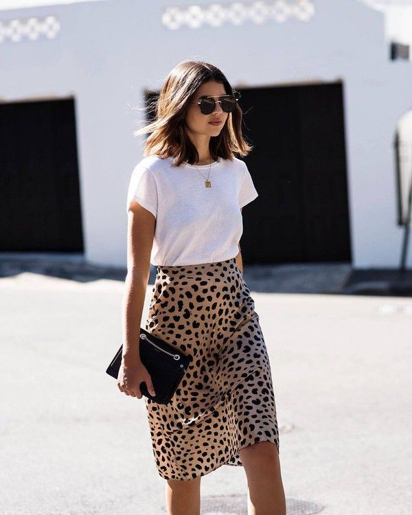 efb513554 There are 2 tips to buy skirt, animal print, midi skirt, silk, white  t-shirt, clutch, chain necklace, aviator sunglasses.