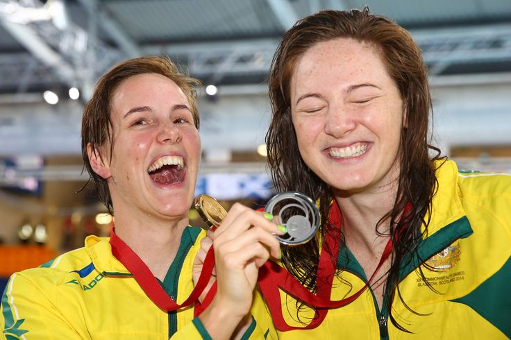 Gold medallist Cate Campbell (R) of Australia poses with silver medallist Bronte Campbell (L) of Australia