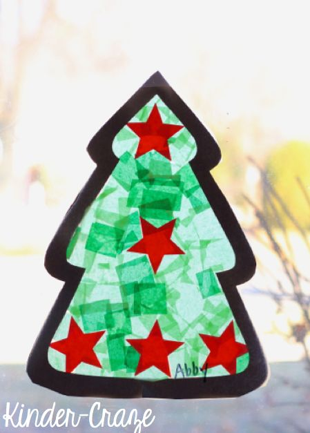 Learn how to make adorable tissue paper Christmas tree stained-glass window decorations for your kindergartern class with this easy, step-by-step tutorial!
