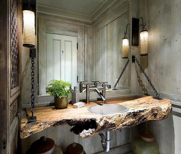 "plank walls, natural wood shelf/ sink. I was thinking of something like this to cover the ""shelf"" right over the gas fireplace. Obviously not with chains and whatnot, but a raw wood shelf would be more attractive."