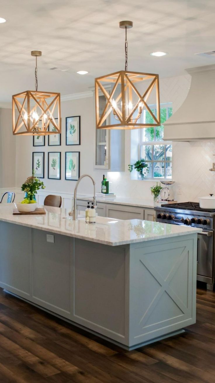 Joanna and Chip Gaines farmhouse kitchen, lower cabinets, lighting, lights, island,  hood, vent, gas stove, #farmhouse #joannagaines #rustic #kitchenisland #hood #vent #lowercabinet #kitchensink #kitchencolor #ad #ss