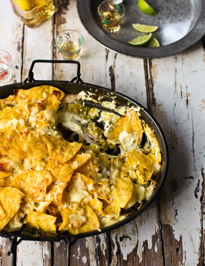 Turkey Chilequiles from the Great British Bake Off Christmas cookbook. Add a bit of winter spice and sunshine to your turkey leftovers with this Mexican dish. Usually made for breakfast or brunch to use up yesterday's tortilla, this more substantial version makes a great comfort-food supper. http://thehappyfoodie.co.uk/recipes/turkey-chilequiles