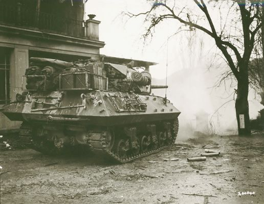 An M10 tank destroyer from the 803rd Tank Destroyer Battalion firing on a German pillbox on the other side of the Sauer River near Echternach Luxembourg supporting an advance by the 5th Infantry Division's 11th Infantry Regiment 7 February 1945.