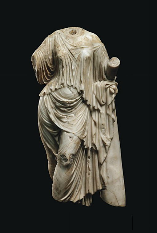 A ROMAN MARBLE APHRODITE   CIRCA 1ST-2ND CENTURY A.D.   Leaning with her left arm bent, her elbow resting atop a pillar, her right arm outstretched, her left leg crossed in front of her right, her drapery falling in heavy folds  16½ in. (42 cm.) high