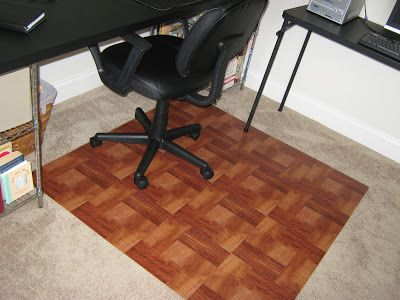 I ran out to Home Depot and picked up this 4' x 4' piece of plywood floor underlayment for $12.00. Then, I picked up 16 of these wood-look self-stick flooring tiles at $0.98 each.  I stuck them onto the plywood and here's the result:   Total Fake-It Cost:  $27.68  Compare to the Fancy Chair Mat from Staples:  $298.00  Total Fake-It Savings:  $270.32
