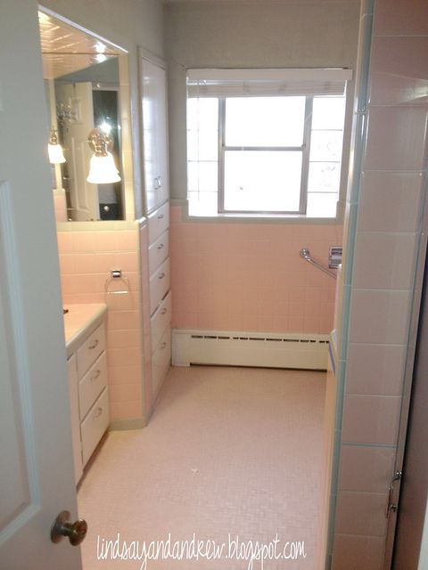 YES!  How to paint bathroom tile - do-able price tag to spruce up an ugly bathroom for now. This is the same nasty pink tile we have!!! There is hope!!!!