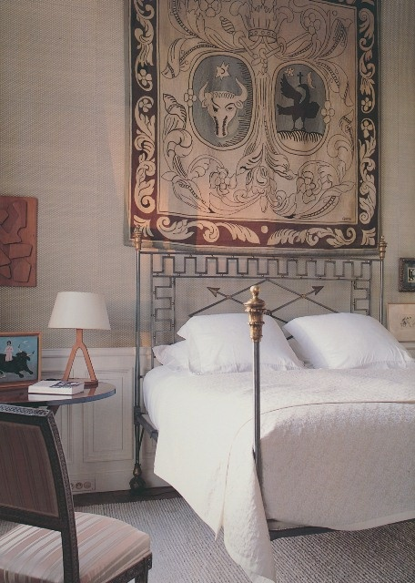 Designer Jacques Grange has rotated this 1930s looking tapestry throughout his Paris home.