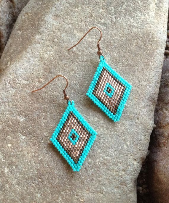 These are Copper Penny and Turquoise Diamond Beaded Earrings. They are light weight. Made with a Brick stitch with turquoise, copper penny and black glass Delica beads. These earrings are 2 long with copper french hooks and 1 wide. This would be a great treat for yourself or a great