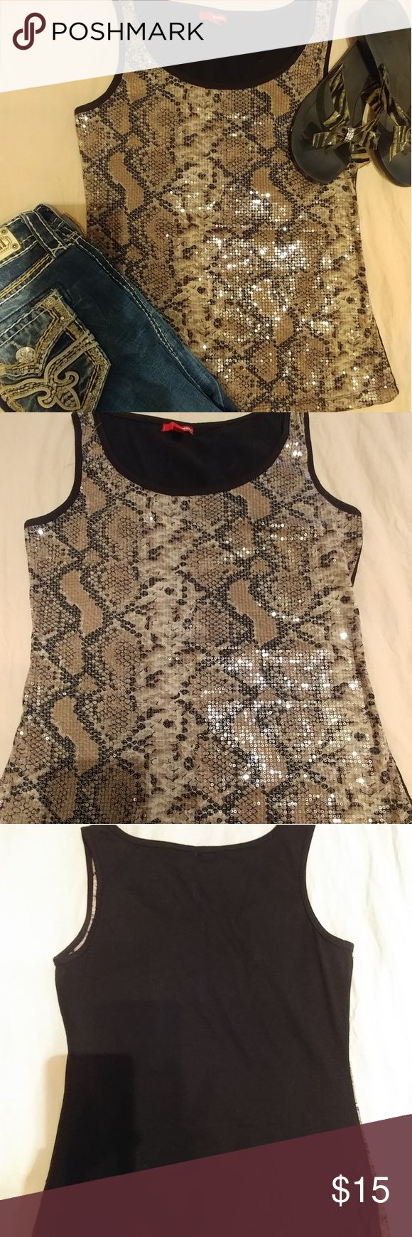 Sequin tank top This unique tank top resembles snake skin with a twist..it's done in sequins! I've worn this both dressed up and down and looks great either way! Tops Tank Tops