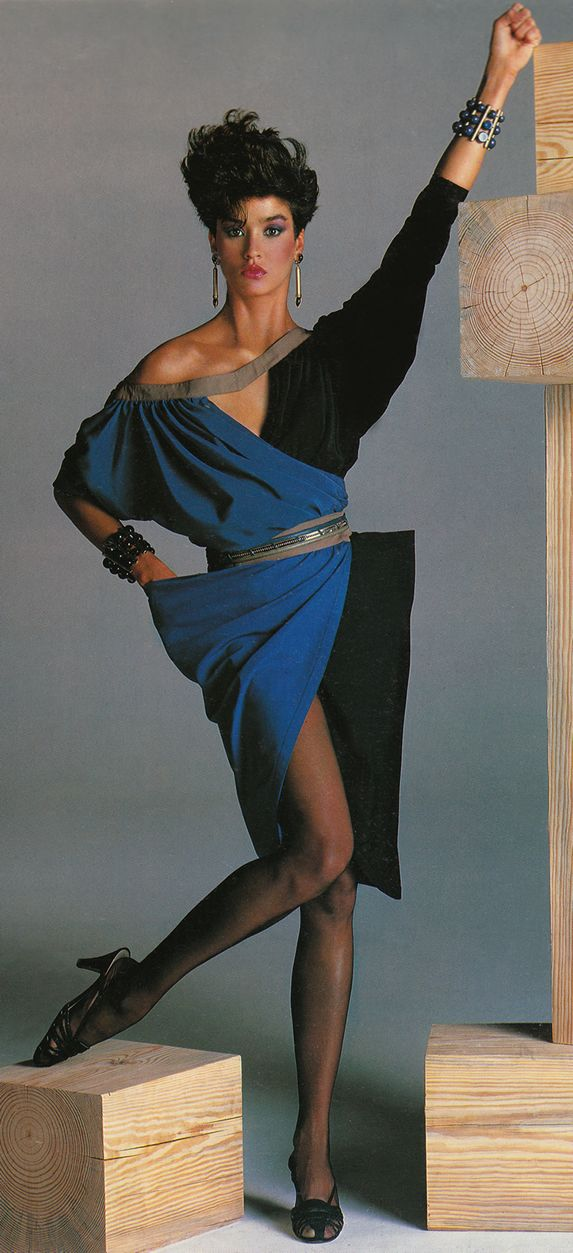 Young Janice Dickinson for Gianni Versace 1983. It has been said that if Georgio Armani designed for the high fashion wife, then Gianni Versace designed for the mistress. Many of Versace's designs were sexy,  form fitting and skin exposing.