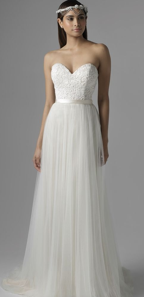 Gorgeous lace bodice tulle skirt A-line wedding dress; Featured Dress: Mia Solano