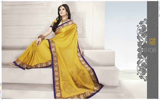 Crepe silk saree in yellow/gold, The Saree is in a lovely soft crepe fabric with gold work all along the border and purple trim.    £149.99