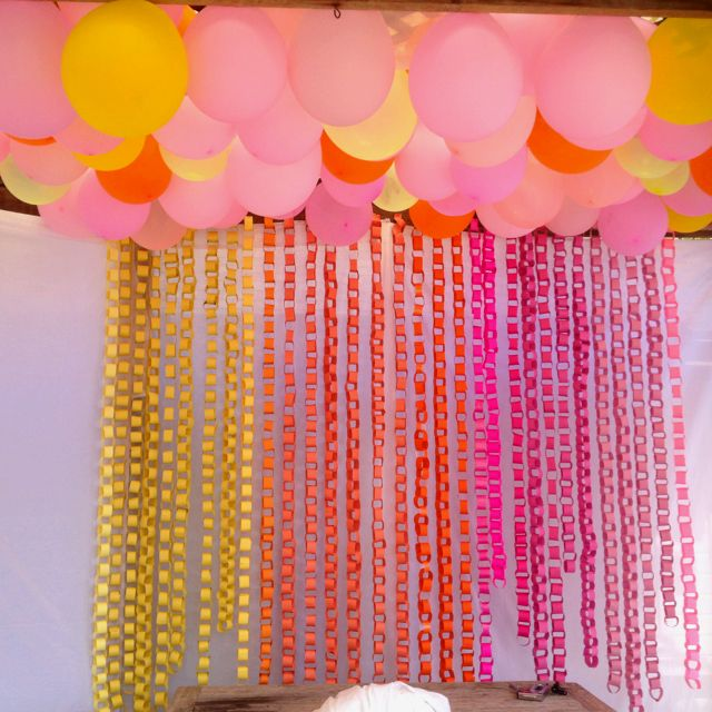Pink Yellow And Orange Paper Chain And Balloon Decoration