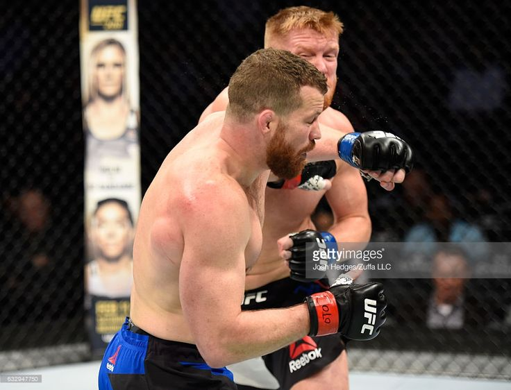 Sam Alvey punches Nate Marquardt in their middleweight bout during the UFC Fight Night event at the Pepsi Center on January 28, 2017 in Denver, Colorado.