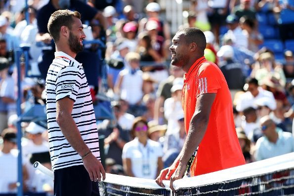 #Tsonga #BenoitPaire #2015USOpen #tennis Jo-Wilfried Tsonga of France greets Benoit Paire of France at the net after defeating him during their Men's Singles Fourth Round match on Day Seven of the 2015 US Open at the USTA Billie Jean King National Tennis Center on September 6, 2015 in the Flushing neighborhood of the Queens borough of New York City. (Photo by Matthew Stockman/Getty Images)