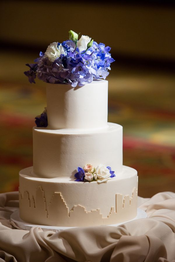 Love the skyline addition to this classic wedding cake!