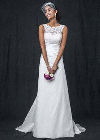 This taffetaA line wedding dress with illusion neckline exudes old world glamour with modern elements!