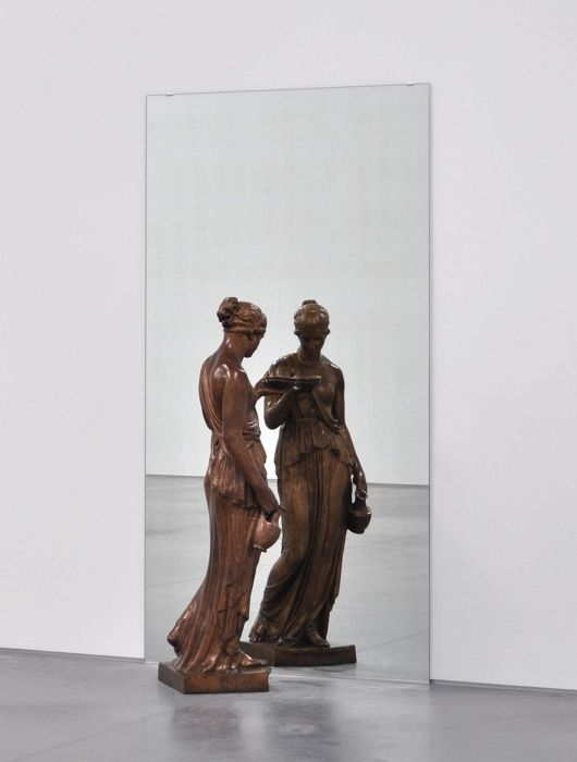 Michelangelo Pistoletto (b. 1933)  Dono di Mercurio allo Specchio, 1971-92  Bronze statue and mirror  Edition of 4   Statue: 146.6 x 45.7 x 53 cm. (57 3/4 x 18 x 20 7/8   in.)   Mirror: 228.9 x 120 cm. (90 1/8 x 47 1/4 in.) Courtesy of Ben Brown Fine Arts