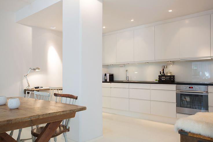 sleek white modern kitchen, eating area