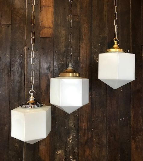 We have a large batch of these lights which makes them ideal for restaurant or retail use. However, they also look fabulous hung alone. Salvaged from the Scarborough Mecca Bingo Hall which was previously the Capitol Theatre and opened in 1929. Medium sized original Art Deco Hexagonal shaped white opaline glass with the original brass galleries. The galleries can be in polished or aged brass. We can also supply these with chrome ...