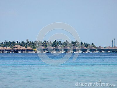 View of luxury resort in Maldives Islands, from beach.