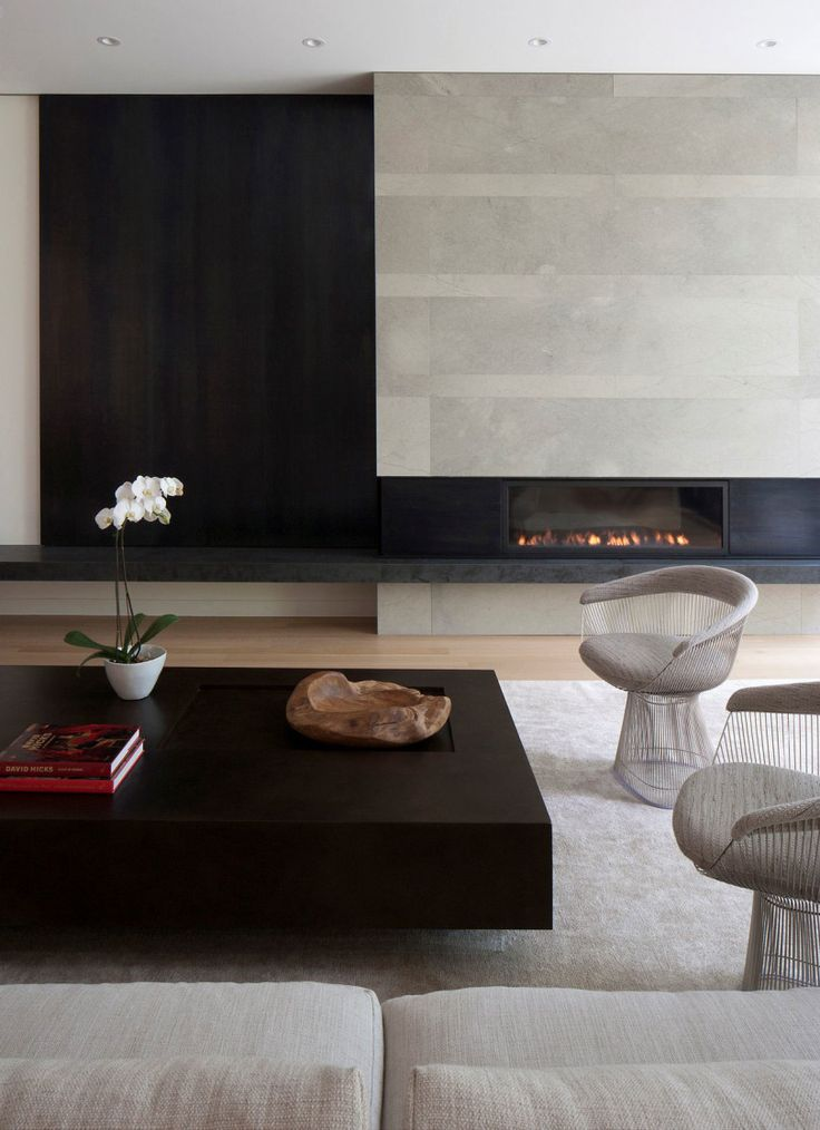 Sleek sitting room with fireplace and stone