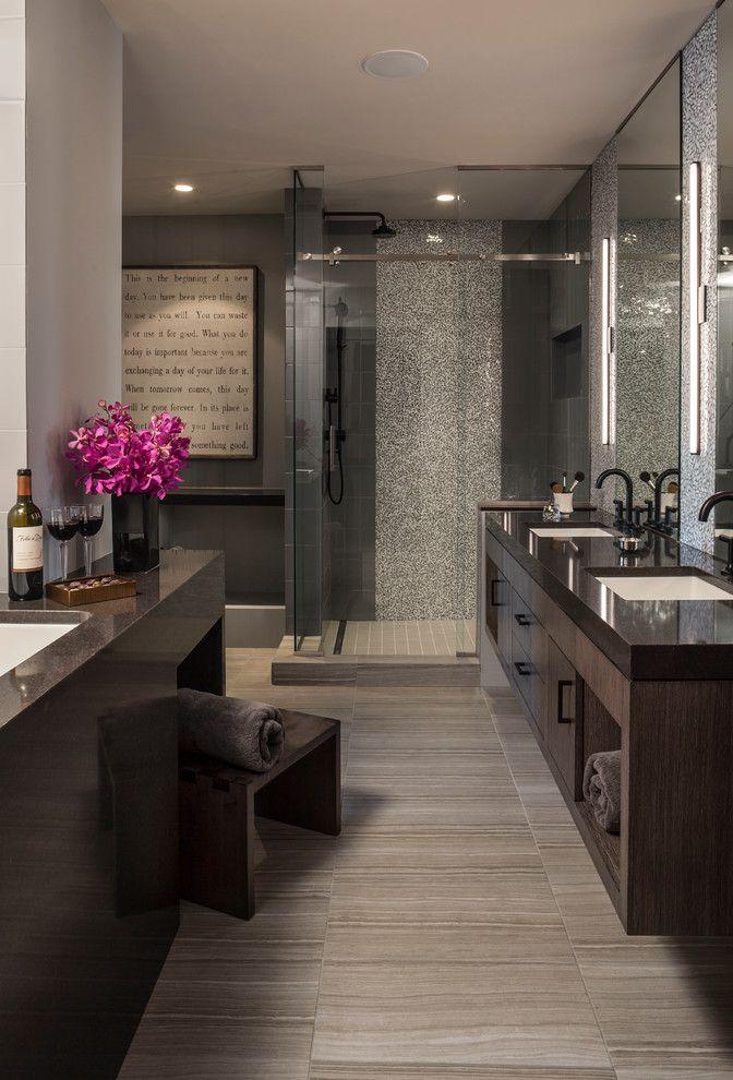Dark master bathroom with glass shower, dark counters, gray walls, double vanity | LiLu Interiors