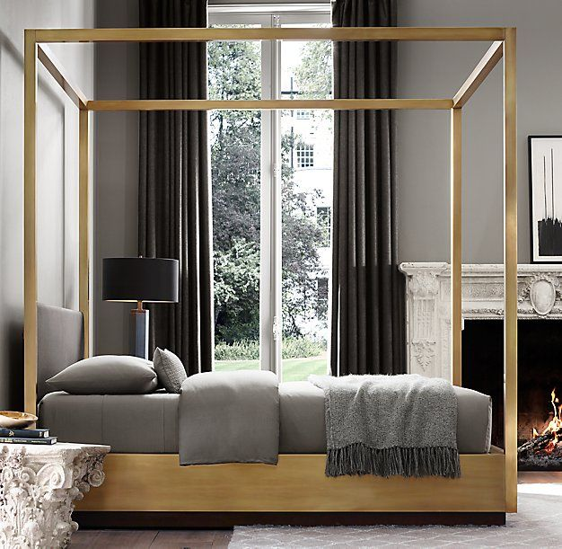 RH Modern's Draper Brass Four-Poster Bed with Headboard:Wrapped in stunning brass sheet metal, our four-poster bed effortlessly assumes center stage. The timeless, burnished finish elevates the classic cube, which sits on an inset base that gives the appearance of floating.