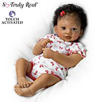Touch-activated So Truly Real® lifelike girl baby doll by award-winning artist Waltraud Hanl coos when you touch her cheek. Fully poseable.