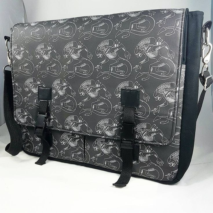 "This custom bag was created for a fan of aliens with my xeno sketch fabric which is available at my Stellar Evolution Designs Spoonflower Shop! Large enough to hold a 19"" x 14"" drawing tablet and containing a facehugging lining it is guaranteed to be a hit with its new artist!  I'm always open to customizing creations!"