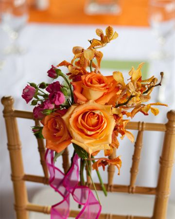 Fuchsia and orange flowers add a pop of color that will liven up your walk down the aisle.