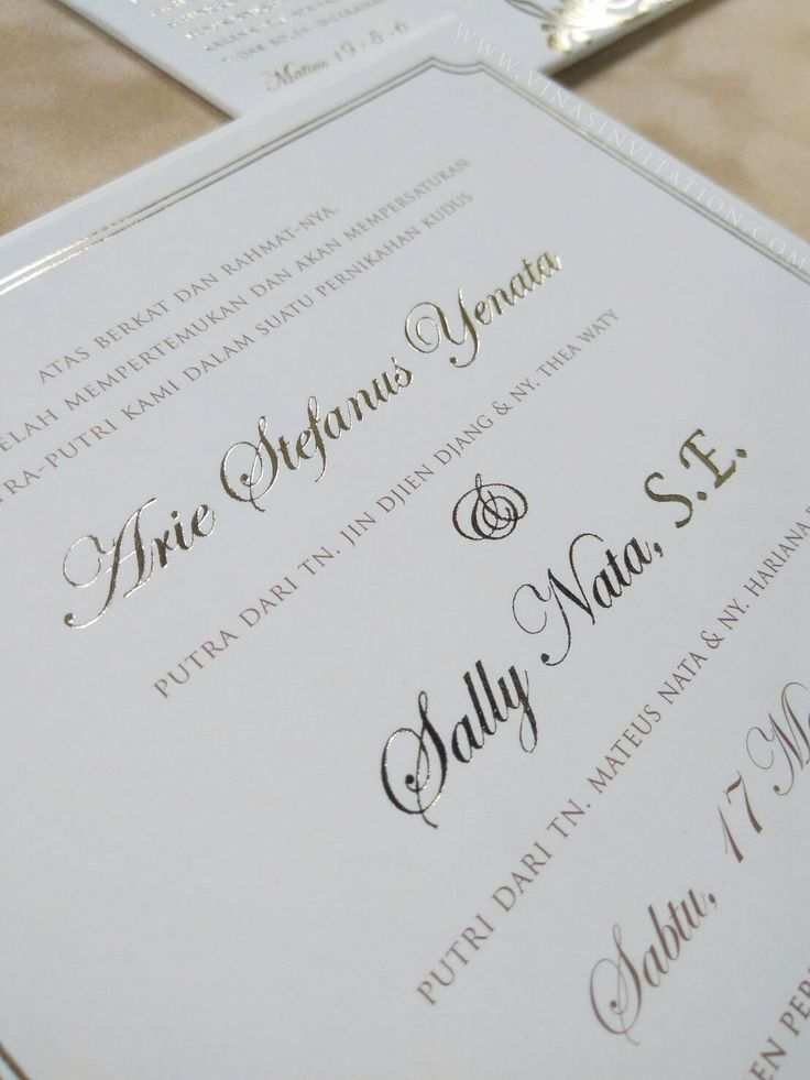 vinas invitation. sydney wedding invitation. indonesia wedding invitation. pure white. simple white invitation..gold font.. any question please visit website www.vinasinvitation.com . courtesy of Arie & Sally