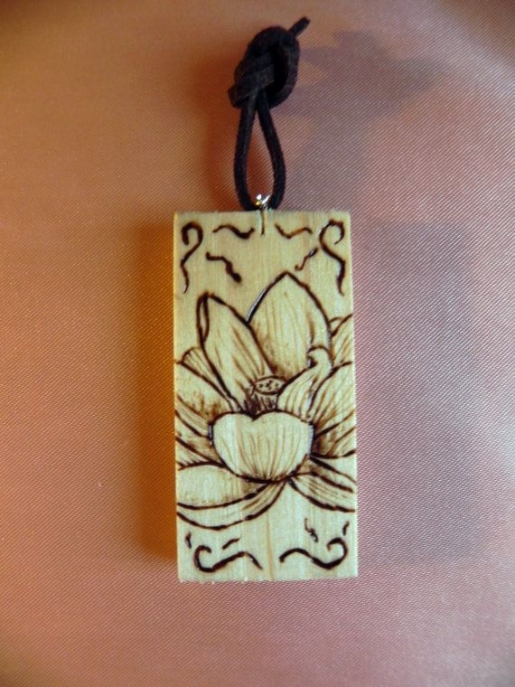 https://www.etsy.com/it/listing/210835047/lotus-flower-on-wood-board-key-chain?ref=shop_home_active_7